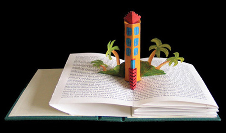 Pop-up by Carol Barton Titled Home Dreams features a tower rising up above the page from the gutter of the book.