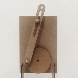 Photo of one of Hyun Joo Oh's paper mechanisms. This one is a crank and shaft made from cardboard.