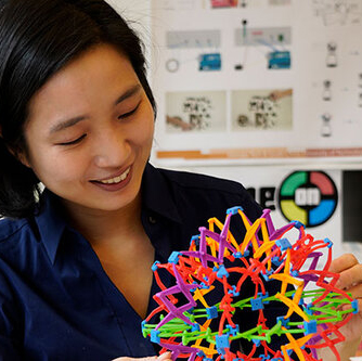 Photo of Hyun Joo Oh playing with a colorful spherical model