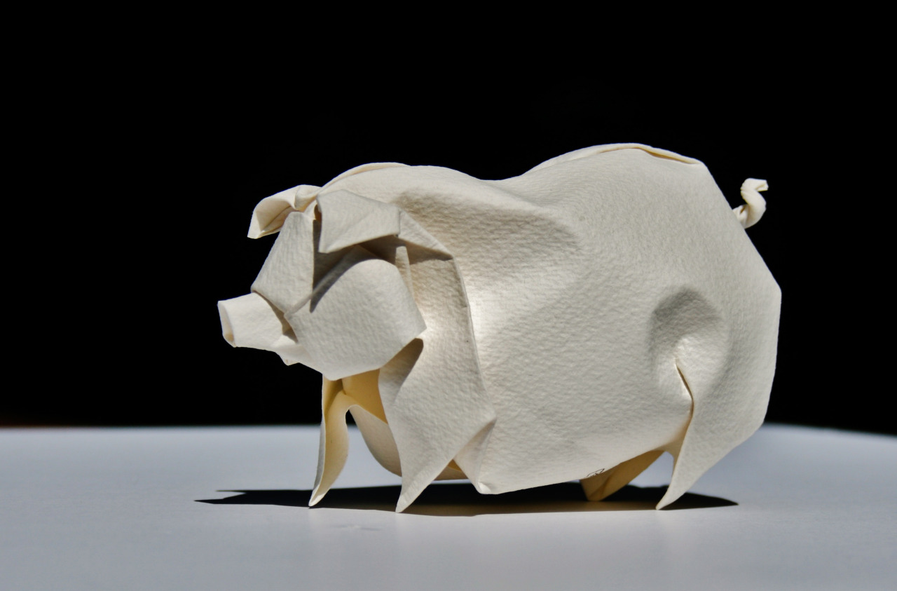 Photo of an origami hog designed and folded by Hoang Tien Quyet
